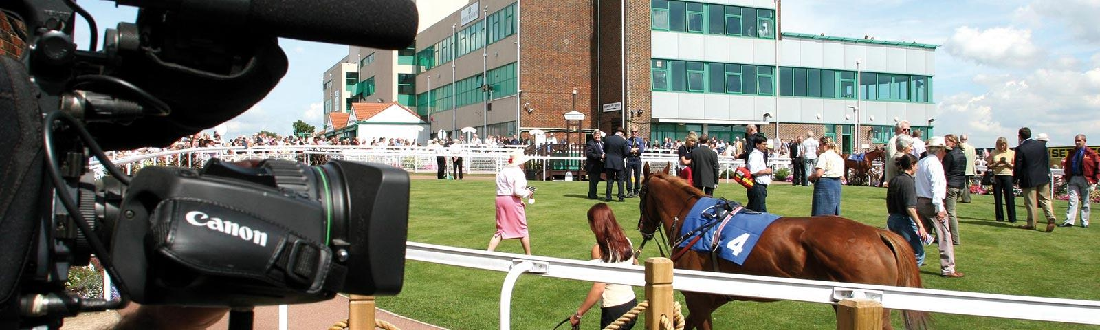 Camera man filming the parade ring